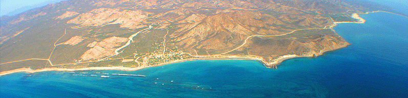 arial view of the Cabo Pulmo Reef structure, surrounding half-moon mountain trimmed bay and mexican village of Cabo Pulmo in Baja Sur Mexico