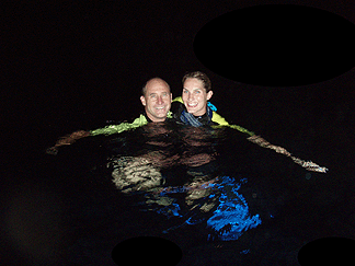 Stacy and Cole enjoy the night waters after dive.